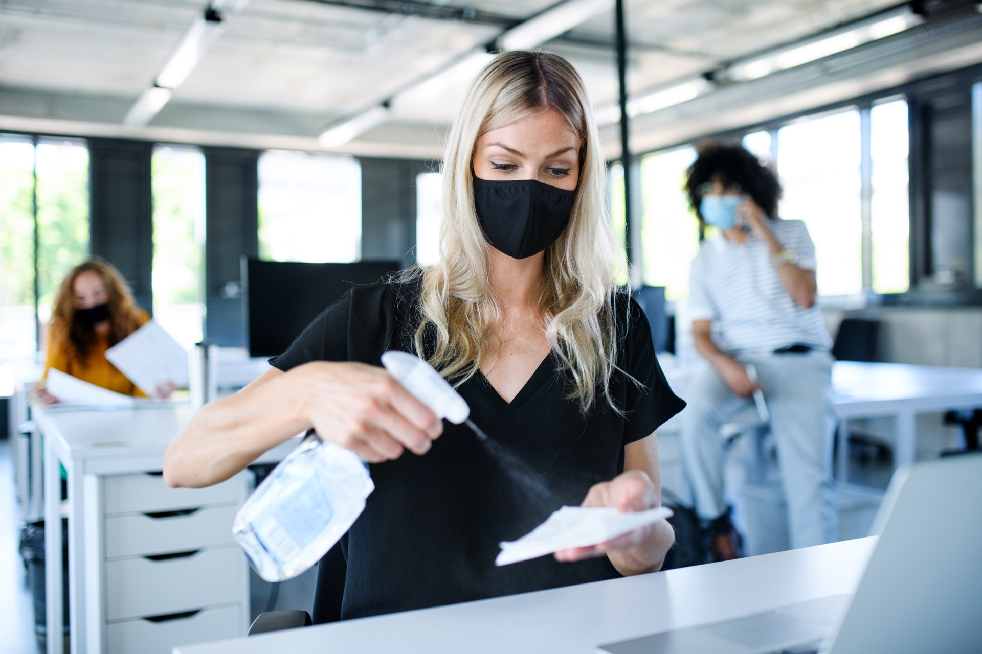 Office cleaning being done by young woman